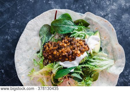 Healthy Plant-based Food Recipes Concept, Vegan Healthy Open Burrito With Mixed Salad Greens Mexican