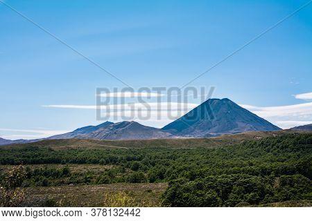 Volcanic Cone Of Mount Ngauruhoe Rising Over Flat Plateau
