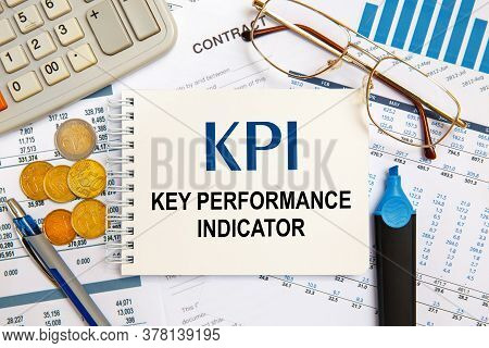 Office Desktop - Photo From Above. Caption - Kpi Key Performance Indicator. Idea, Evaluation.