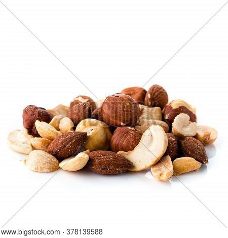 Pile Of Multiple Nuts, Mix Of Salted Hazelnuts, Almonds, Cashews And Peanuts Isolated On A White Bac