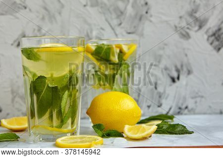 Refreshing Drinks For Summer, Cold Sweet And Sour Lemonade Juice In The Glasses With Sliced Fresh Le