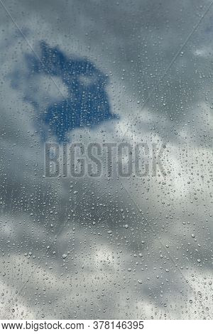 Close Up Of A Window With Rain Drops Falling Down. Focus On Rain Drops. Rain Drops On Rainy Day On O