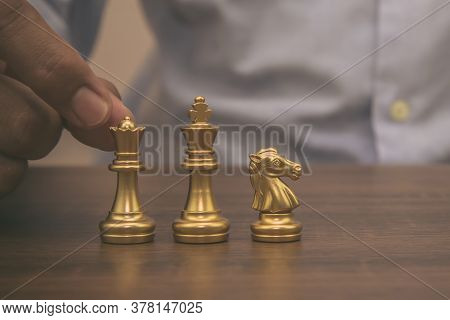 Close-up Hand Choose Chess On Chess Board Concept Of Business Strategic Plan And Professional Teamwo
