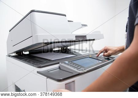 Closeup Hand Press Button To Using The Photocopier Or Xerox Machine Is Office Work Tool Printer Equi