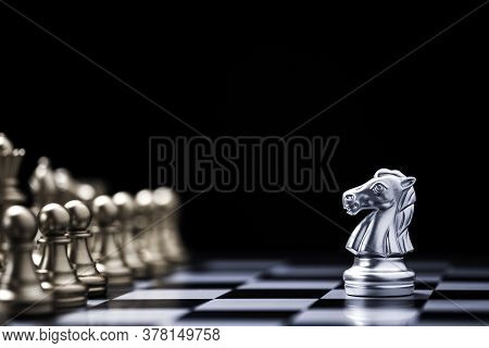 Silver Horse Chess Encounters With Gold Chess Enemy On Chess Board And Black Background. Market Or B