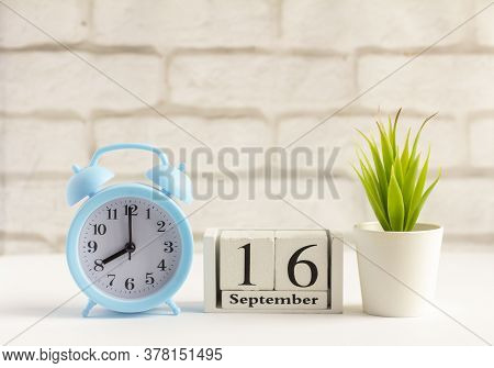 September 16 On A Wooden Calendar Next To The Alarm Clock.september Day, Empty Space For Text.calend