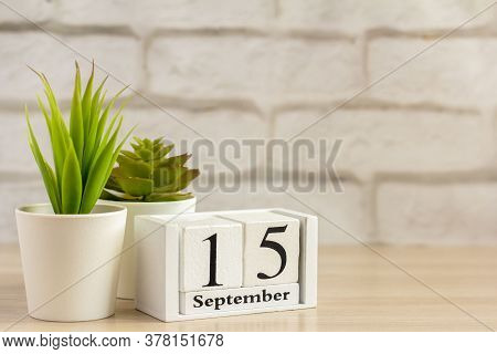 September 15 On A Wooden Calendar On A Table Or Shelf.one Day Of The Autumn Month.calendar For Septe