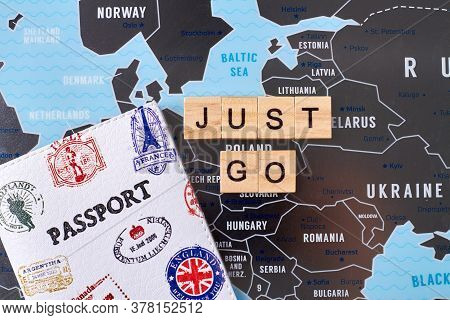 Passport With Many Stamps Of Different Countries And Just Go Slogan. Travel Agency Company Advertisi