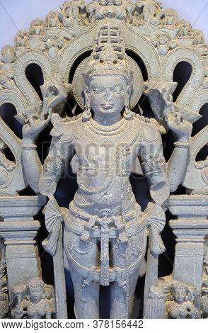 MUMBAI, INDIA - FEBRUARY 14, 2020: Statue of Vishnu from 12th-13th century exposed in the Prince of Wales Museum, now known as The Chhatrapati Shivaji Maharaj Museum in Mumbai, India
