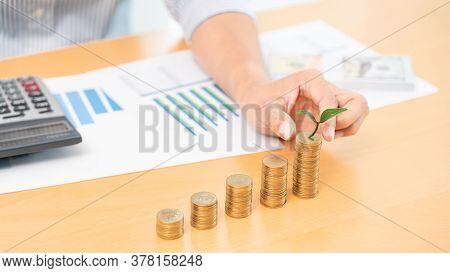 Saving Money And Investment Concept, Business Accountant Woman Stacking Coins Into Increasing Column