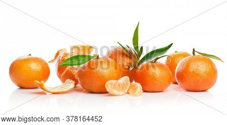 Ripe tangerines with green leaf in cut. Fruity still life citrus. Isolated on white background.