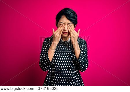 Young beautiful asian woman wearing casual jacket standing over isolated pink background rubbing eyes for fatigue and headache, sleepy and tired expression. Vision problem