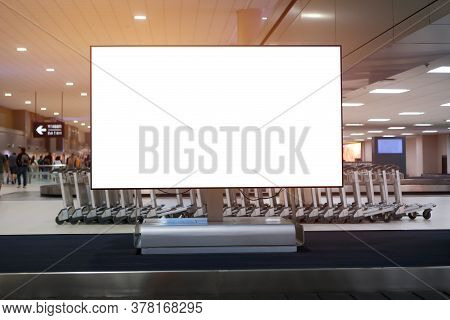 Lcd Blank Billboard At Conveyor Belt Luggage In Airport. Copy Space For Cutomer Text Information Adv