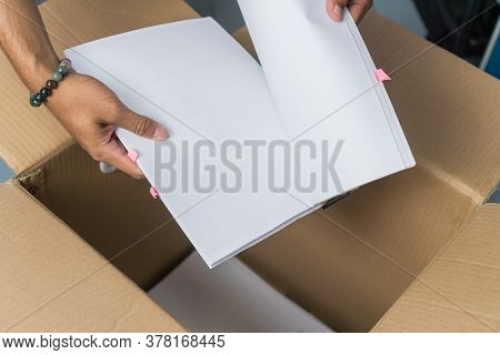 Businessman Pick Heap Used Documents Or Paperwork From Unpacks Cardboard Boxes To New Workplace Offi