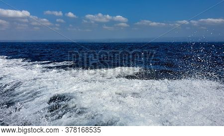 View Of The Ocean Waves And The Blue Sky From A Fast Boat In Bali, Indonesia. Bali Fast Boat Ride In