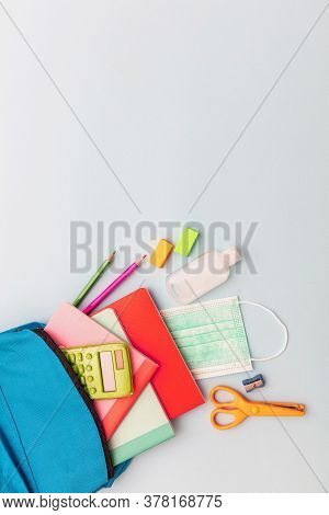 Sanitizer Gel, Medical Mask And School Supplies, Blue Color Background