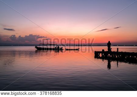 Sunset Pier Albufera Valencia Tourist Ride Boat Reflections In The Lake Natural Park Spain.