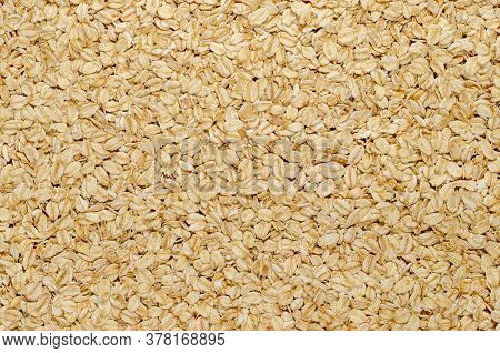 Rolled Oats, Surface And Background. Lightly Processed Whole-grain Food. Husked And Steamed Oat Groa