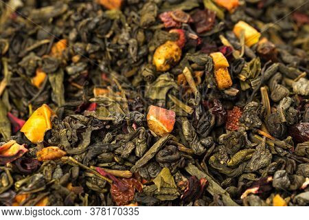 Leaves Of Chinese Dry Tea Top Grade With Goji Berries And Powdered Acai On White Background