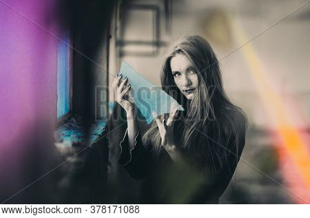 Girl Dressed As Witch Holding Broken Glass, Mirror, Sign Of Bad Luck. Halloween Concept