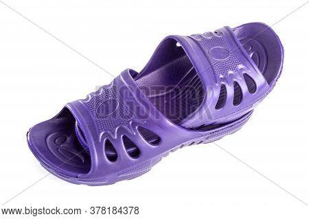 Pair Of Cheap Durable Purple Rubber Slippers One Inside Other Isolated On White Background.