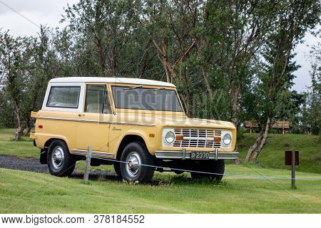 Iceland - July 4, 2014: Very Old Ford Bronco, The First Generation Of Legendary Suv Parked At Grass