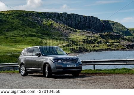 Duntulm Castle, Scotland - August 5, 2019: The Legendary Range Rover L405 Type Suv Parked In A Beaut