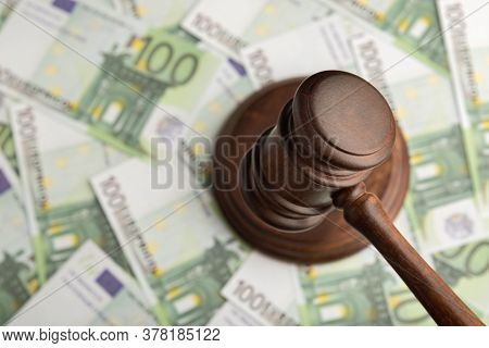 Judge Hammer On Euro Banknotes Background. Judge Gavel On The Money. Corrupt Court