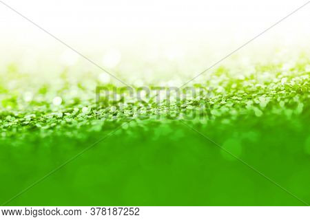 Soft focus Green glitter shine dots confetti. Abstract light blink sparkle background.