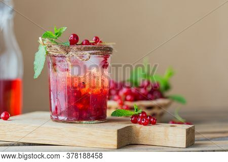 Glass Jar Of Red Currant Soda Drink On Wooden Table. Summer Healthy Detox Lemonade, Cocktail Or Anot