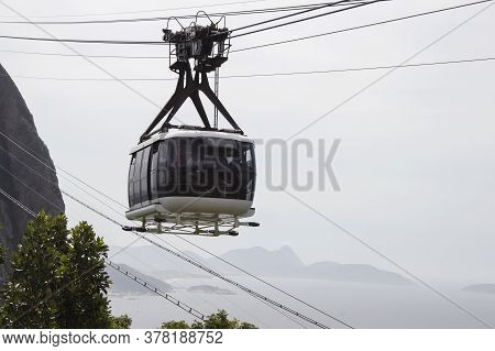 Rio De Janeiro; Brazil - February, 12, 2019: Cable Car With Tourists Traveling To Sugarloaf Mountain
