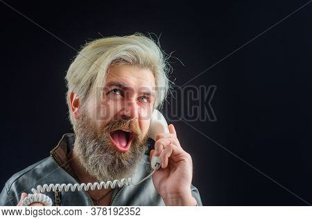 Bearded Man With Telephone Handset. Handsome Man Talking At Retro Handset. Bearded Man With Handset.