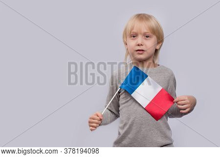 Fair-haired Boy Holding Flag Of France. Training In France. Learning French For Children.