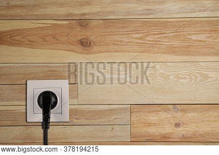 Wooden Wall With Power Socket And Inserted Plug, Space For Text. Electrical Supply