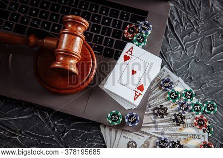 Law And Rules For Online Gambling Concept, Judge Gavel With Playng Cards, Playing Chips And Money Ba