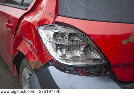 Broken Headlight On A Car. Deflated Wheel At The Car. The Car After The Accident. Transport Repair.