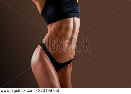 Beautiful Super Fit Young Woman Showing Off Her Perfect Muscular Ripped Abs. Fitness Model. Perfect