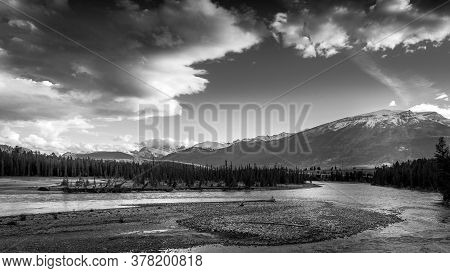 Black And White Photo Of Daybreak Over The Athabasca River Near The Town Of Jasper In Jasper Nationa