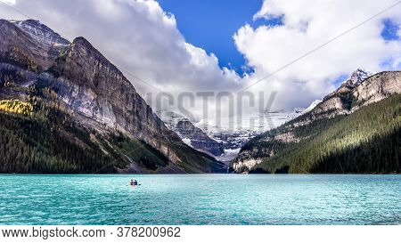 Canoeing On The Turquoise Waters Of Lake Louise In The Rocky Mountains In Banff National Park, Alber