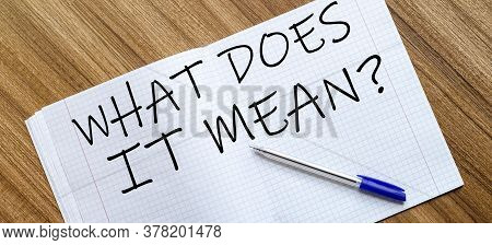Blank Notebook And Pen. Isolated On White. Whith Text What Does It Mean