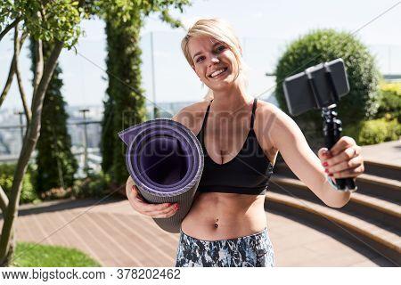 Joyful Sportswoman Taking Selfie Outdoors And Smiling