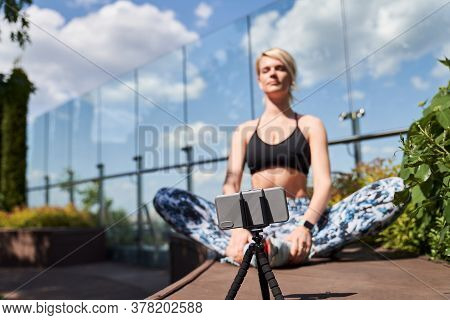 Yoga Teacher Recording Herself On The Camera For Her Students