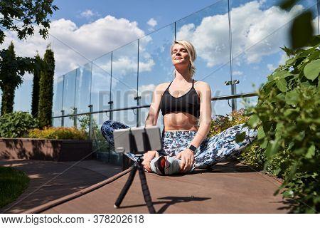 Confident Mirthful Woman Recording Her Yoga Training