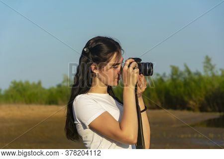 Young Woman Photographs The Landscape On A Summer Day. Photographic Profession.