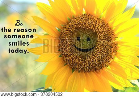 Inspirational Quote - Be The Reason Someone Smiles Today. With Closeup Of Beautiful Smiling Sunflowe