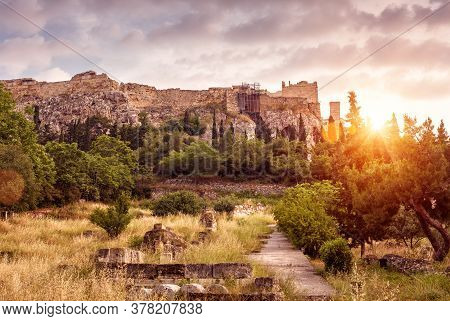 Landscape Of Athens, Ancient Agora Overlooking Acropolis Hill At Sunset, Greece. Scenic Sunny View O