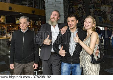 08.03.2019 Kiev Ukraine A Young Couple - A Guy And A Girl Are Photographed With Two Elderly Men. Fou