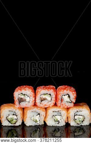 Philadelphia Roll With Salmon, Cheese And Cucumber On A Black Background With Reflection. Sushi Phil