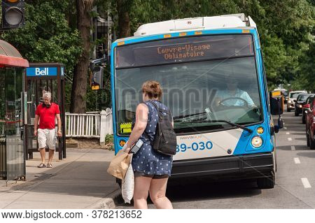 Montreal, Ca - 26 July 2020: Digital Signage On Bus Stating That Face Masks Are Required To Board Th