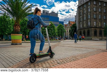 City Bike. Electric Kick Scooter Using From Woman. Urban Lifestyle Background. Electric Urban Transp